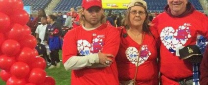 """Lisa Holton-Snider with her son Gary Snider and husband, William Holton-Snider at last year's Metro Detroit Heart Walk. She'll participate again this year as part of BCBSM team """"We've Got the Beat."""""""