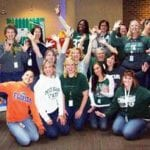 Lansing employees show their team spirit as part of a food drive competition that pitted MSU fans against U of M rivals.