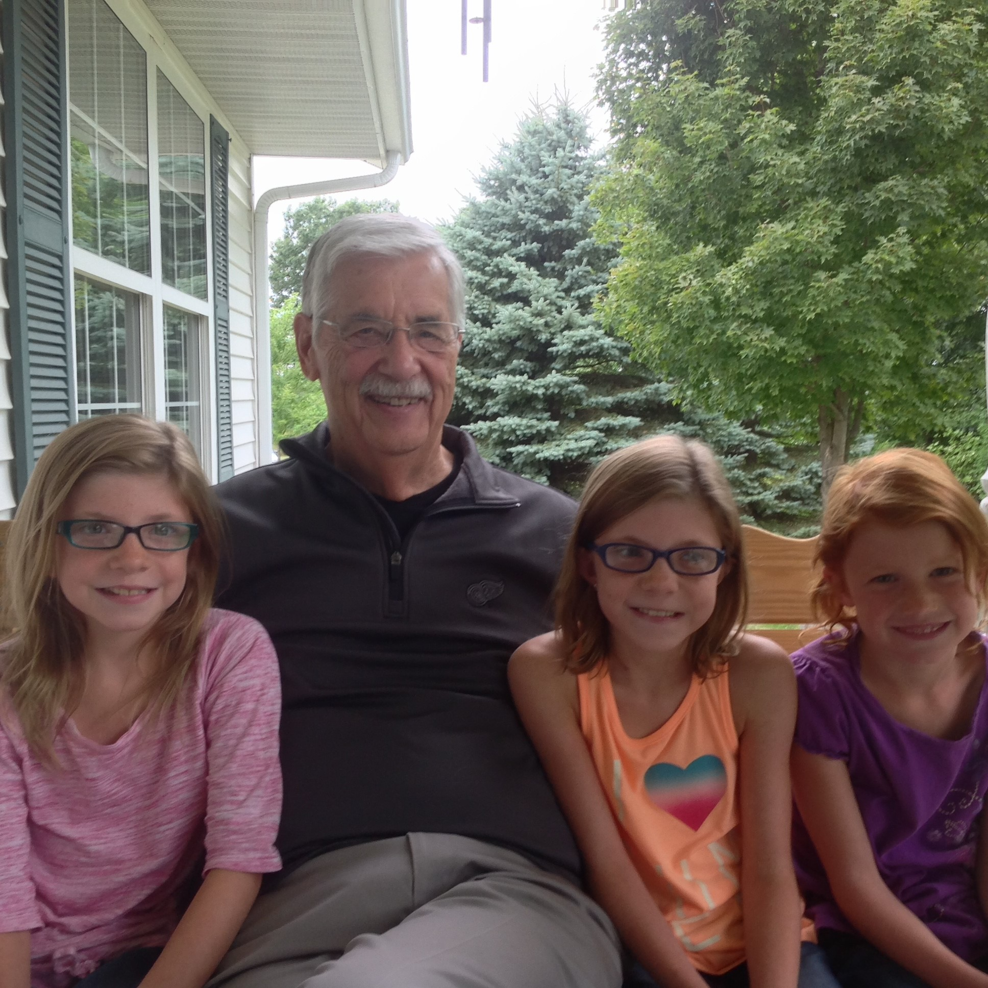 Bill Crooks, 83, with his three grandchildren.