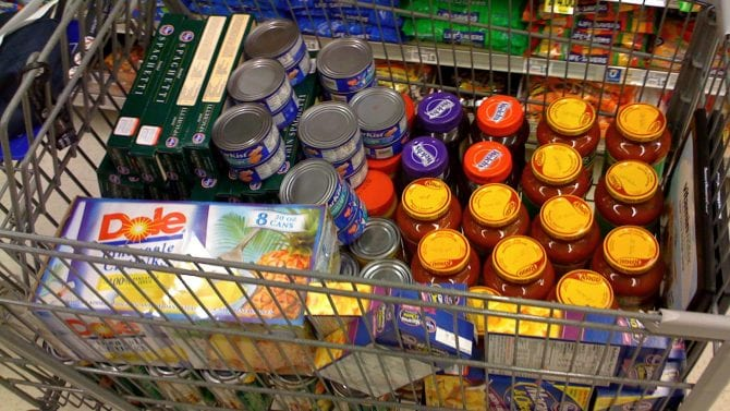 Canned and boxed foods in a grocery cart