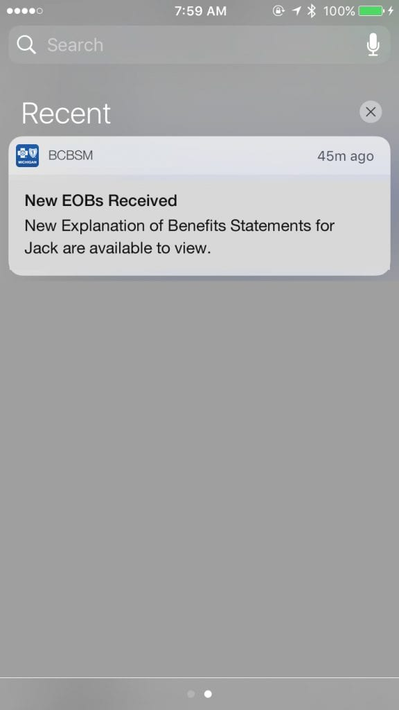 "EOB notification is shown on an iphone. It reads ""New explanation of benefits statements for Jack are available to view."""