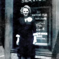 Woman in front of a Michigan Medical Service sign