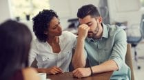 Cropped shot of a wife consoling her husband during a counselling session with a therapist