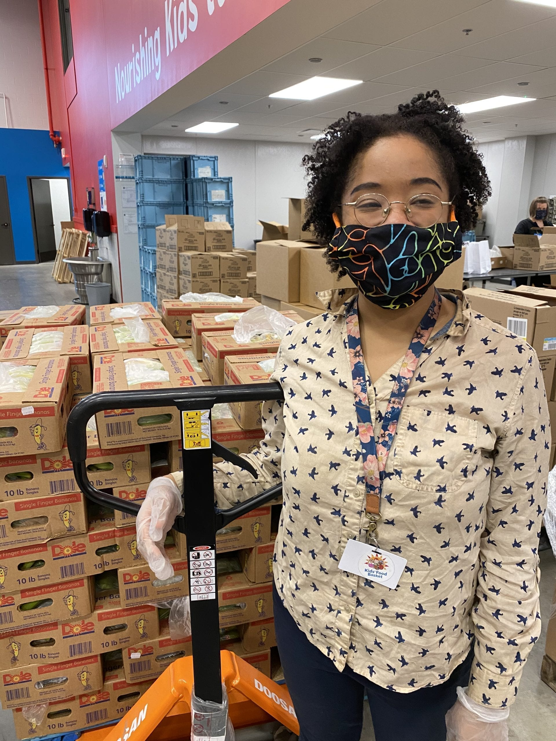 Worker wearing a mask at Kids' Food Basket